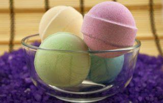 Bath balls in glass bowl on the violet salt