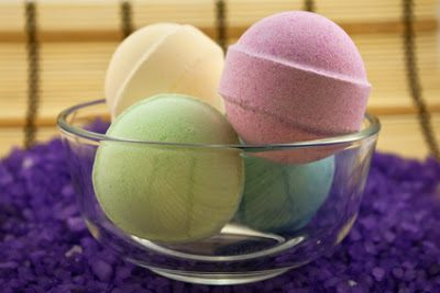 Bath balls in glass bowl on the violet salt