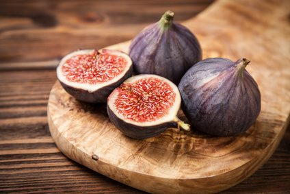 Delicious fresh figs on a wooden board