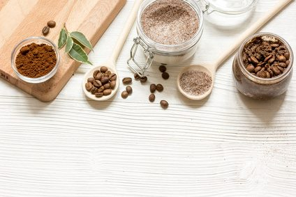 homemade coffee-sugar scrub top view on wooden background