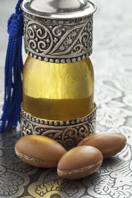 Bottle with moroccan argan oil and nuts