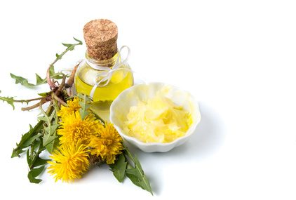 Dandelion flowers with tincture and salve isolated